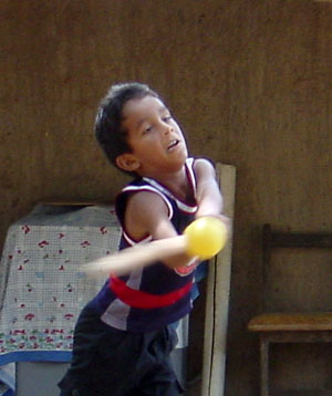 [Kid playing baseball]
