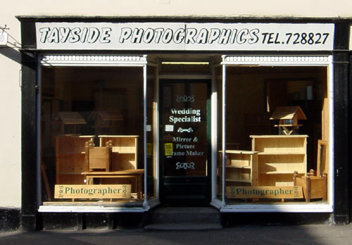 [Photography shop with only furniture on display]